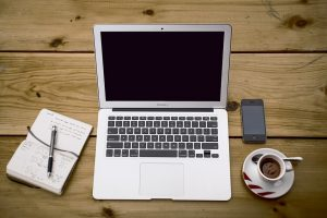 research a topic before writing by using your laptop